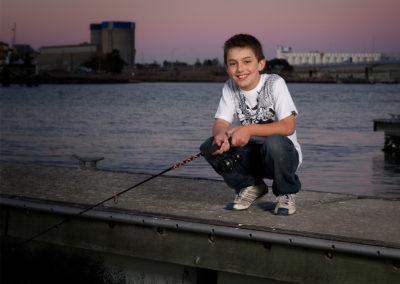 youg man fishing portrait at port adelaide
