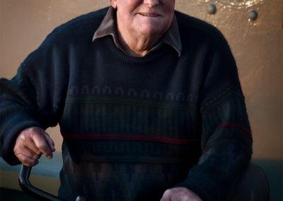 man portrait at port adelaide tug boat