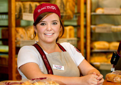 Lady in bakery serving