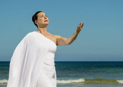 Lady on beach dance for peace