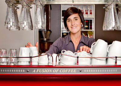 lady barista behind coffee machine